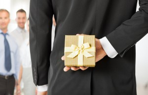 photodune-5106419-man-hands-holding-gift-box-in-office-m-300x192